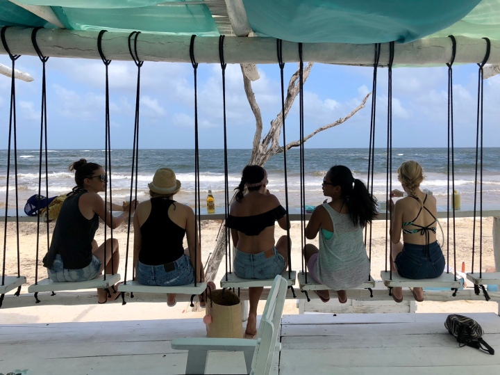 {Swinging while we enjoy the view and a few appetizers at Coco Tulum Beach Club}
